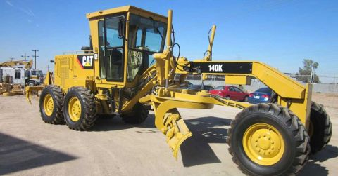 A 'like-new' fully reconditioned 140K Caterpillar motor grader.
