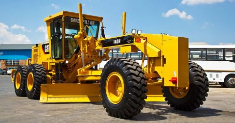 A 'like-new' fully reconditioned 140H Caterpillar motor grader.
