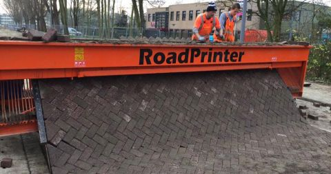 A road printing machine laying pavement.