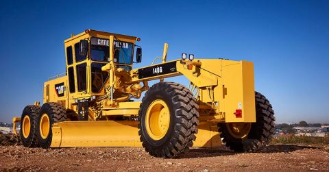 A used 140H Caterpillar motor grader.