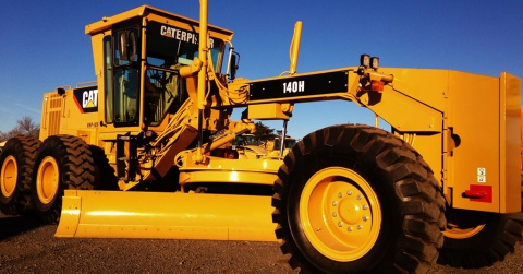 A sparkling clean fully reconditioned 140H Caterpillar motor grader.