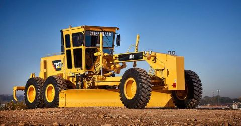 A fully reconditioned 140G Caterpillar motor grader.