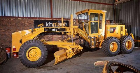 A 'like-new' fully reconditioned 140G Caterpillar motor grader.